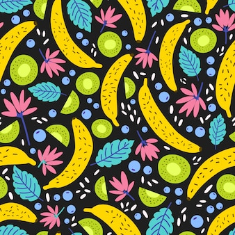 Seamless pattern with exotic blooming flowers and tropical fruits.