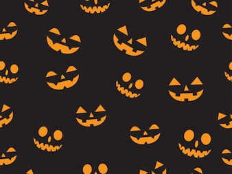 Seamless pattern with faces pumpkin devil
