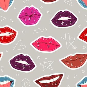 女性の唇とのシームレスなパターン。カラフルな口紅の唇