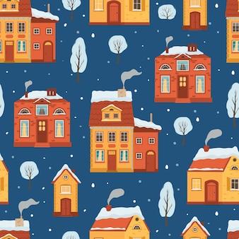 フラットスタイルの冬の家とのシームレスなパターン。居心地の良い町とクリスマス休暇の背景