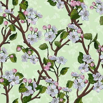 Seamless pattern with flowering apple tree diagonal branches