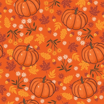 Seamless pattern with flowers, autumn leaves and pumpkins. vector graphics.