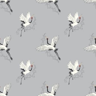 Seamless pattern with flowers and white japanese cranes.