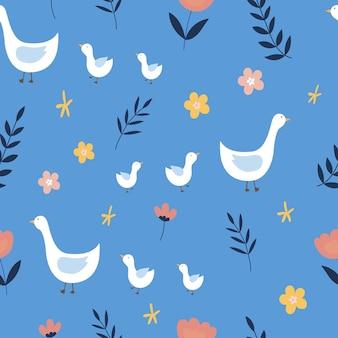青い背景にガチョウと花とのシームレスなパターン