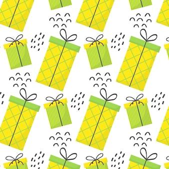 Бесшовный образец с подарками образец с зелеными и желтыми подарками