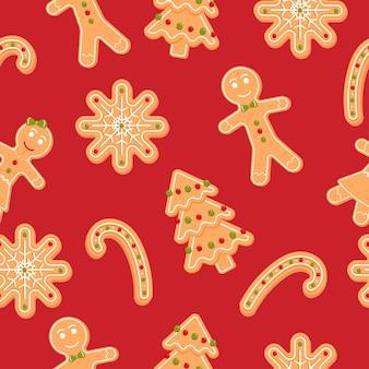 ジンジャーブレッドマンのスノーフレークとキャンディーのクリスマスクッキーとのシームレスなパターン