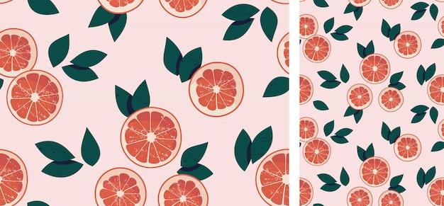Бесшовный фон с грейпфрутами и листьями