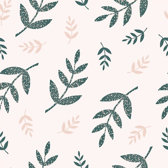 Seamless pattern with green and beige branches and leaves on a light background in hand drawn style