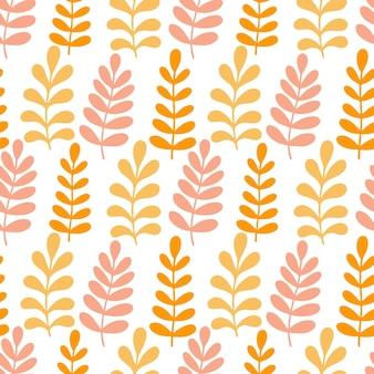オレンジと黄色の成長の葉とのシームレスなパターン。