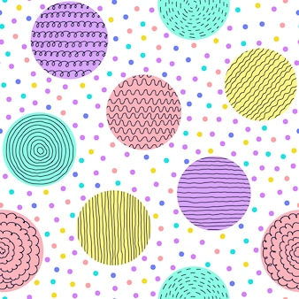 斑点のある背景に手描きの円とのシームレスなパターン。