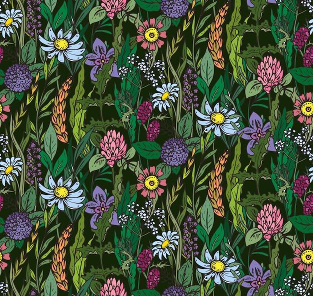 手でシームレスなパターンには、花とハーブが描かれています。