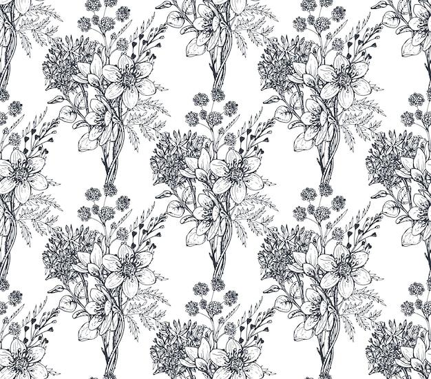スケッチスタイルで手描きの花や植物とのシームレスなパターン。モノクロパターン