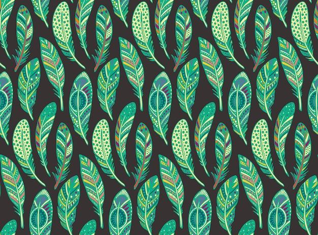 手描きの華やかな部族のカラフルな羽とのシームレスなパターン。