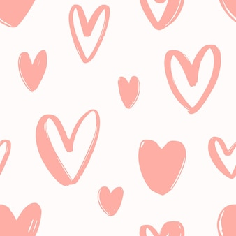 Seamless pattern with hand drawn pink hearts on white background