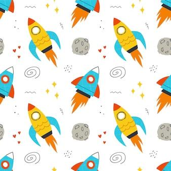 손으로 그린 로켓, 우주 요소, 별과 함께 매끄러운 패턴입니다. 어린이 디자인, 섬유, 의류, 벽지에 대한 배경.