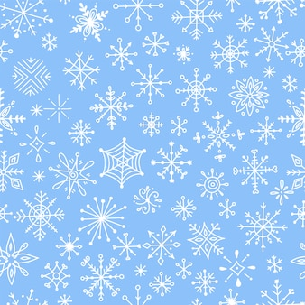 Seamless pattern with hand-drawn snowflakes.