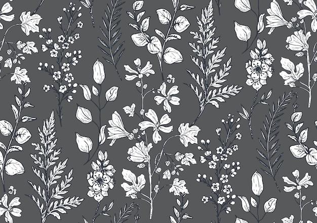 スケッチ風の手描きの春の花や植物とのシームレスなパターン。モノクロ