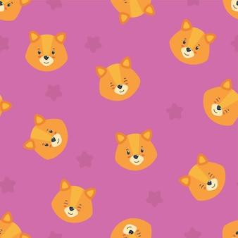 ピンクの背景の幸せな子犬の頭とのシームレスなパターンさまざまなデザインのかわいい子犬のプリント