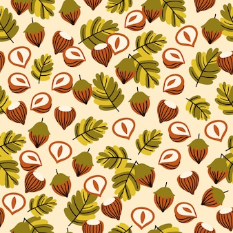 Бесшовный фон с листьями лесного ореха и желудями.