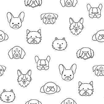 異なる品種の犬の頭とのシームレスなパターン