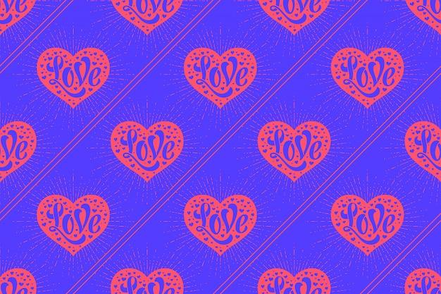 Бесшовный фон с сердцем и надписью love