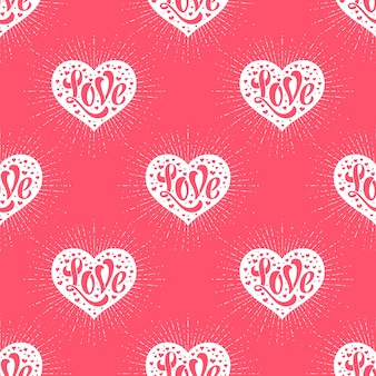 Seamless pattern with heart and lettering love