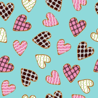 Seamless pattern with heart shaped cookies with sugar icing