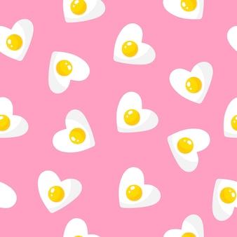 Бесшовный фон с омлетом в форме сердца, завтраком на день святого валентина.