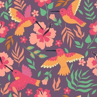 ハチドリとハイビスカスとのシームレスなパターン。ベクトルグラフィックス。