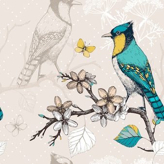 Seamless  pattern with ink hand drawn birds on blooming  tree twigs. vintage sketch background with green birds