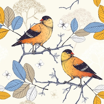 Seamless  pattern with ink hand drawn birds on blooming  tree twigs. vintage sketch background with orange birds
