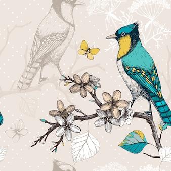 インクとのシームレスなパターンは、咲く木の小枝に鳥を手描きします。緑の鳥とビンテージスケッチの背景