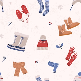 Seamless pattern with knitted apparel and winter boots on light background