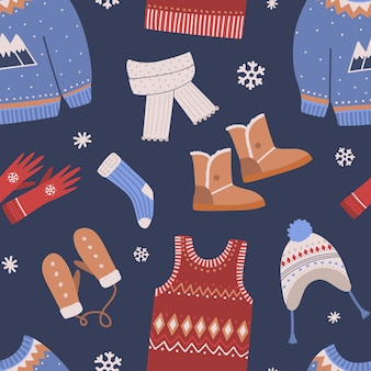 Seamless pattern with knitted winter clothes on dark