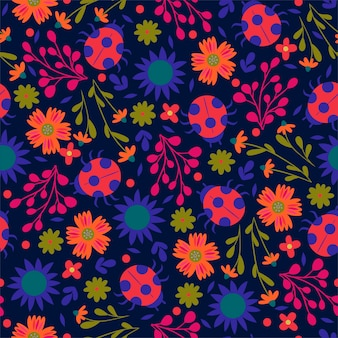 Seamless pattern with ladybirds and flowers