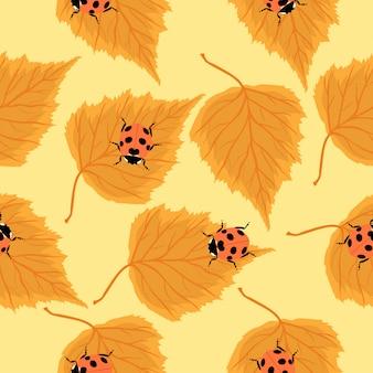 てんとう虫と白樺の葉のシームレスなパターン。グラフィックス