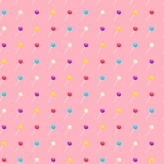 ロリポップの甘いキャンディーとのシームレスなパターン。ピンクの背景のベクトル図