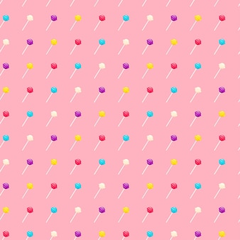 Seamless pattern with lollipop sweet candies. vector illustration on pink background