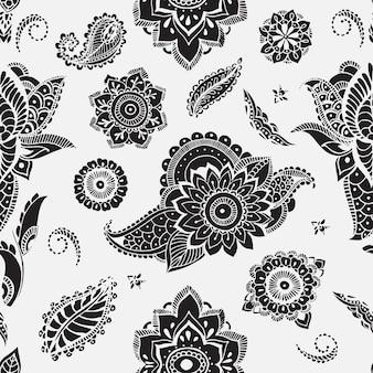 一時的な刺青要素とのシームレスなパターン。定型化された花、葉、インドのペイズリーと花の壁紙。