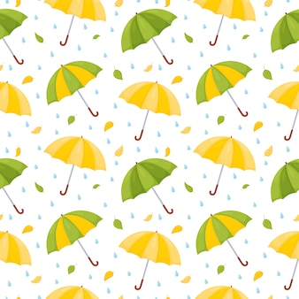 Seamless pattern with multicolored umbrellas, raindrops and falling leaves.