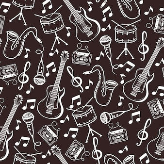 Seamless pattern with musical instruments in doodle style.