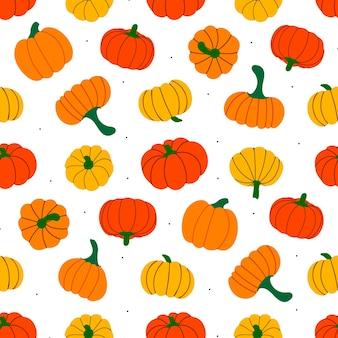 オレンジ色の秋のカボチャとのシームレスなパターン