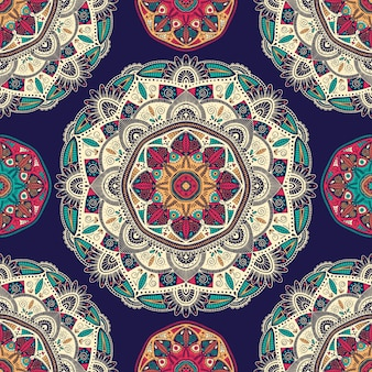 Seamless pattern with ornamental floral ethnic mandalas