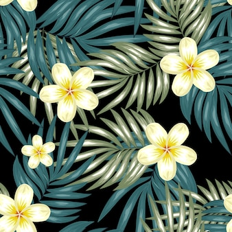 Seamless pattern with plumeria flower and palm leaf