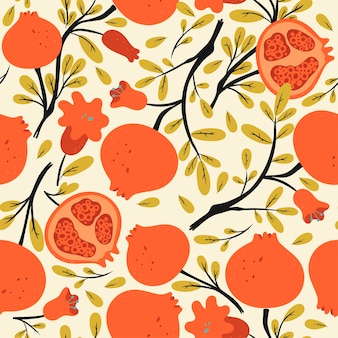 Seamless pattern with pomegranates on the branches