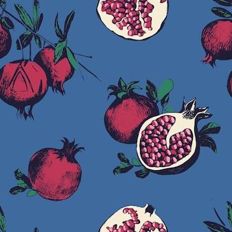 석류와 함께 완벽 한 패턴입니다. 파란색 배경에 과일입니다.