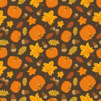 カボチャのどんぐりとオレンジ色のカエデとオークの葉のシームレスなパターンは、自然と明るい秋のプリントを残します...