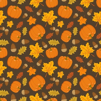 Seamless pattern with pumpkin acorns and orange maple and oak leaves bright autumn print with nature...