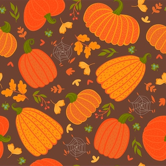 カボチャと葉とのシームレスなパターン。ベクトルグラフィックス。
