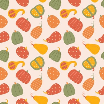 Seamless pattern with pumpkins vector autumn texture in flat style on a light pink background.